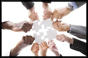 teamwork-puzzle-organized-pieces-together-frame